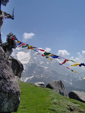 Tibetan prayer flags flying from a mountain top